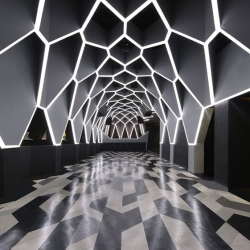 Geometric graphics run throughout Roxy/Josefine Club in Belo Horizonte, Brazil, and resembles a gigantic sci-fi bee's nest - with bold, sumptuous colors lending it a futuristic yet decidedly opulent aura.