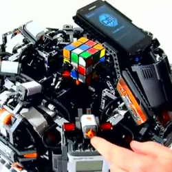 CubeStormer II solves the Rubik's Cube puzzle faster than the human world record.