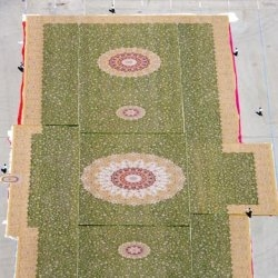 Iran unveils huge rug intended for the floor of a new mosque in the UAE. This colossal carpet wieghs 38 tonnes, and contains over 2.2 billion knots!