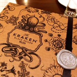 Best. Packaging. Ever? Take a peek inside this mysterious box from The Kraken Rum ~ the details of the box, the seal, the letter, the bottle, the ltd ed print, poster, tooth in a vial, book, ink, feather, and MORE...