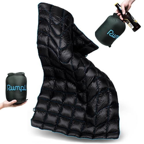 Rumpl Down Puffy - a trekking size throw that feels like a sleeping bag, and is super warm with it's 600 fill duck down! NOTCOT takes it to a cozy cabin to test it out and share the details with you.