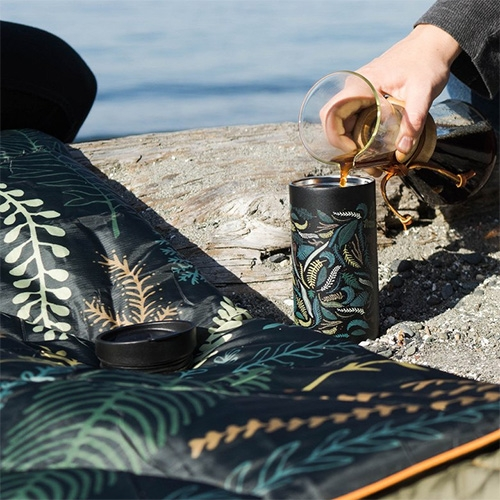 Rumpl x MiiR holiday collaboration collection features a great fern print on a puffy blanket and insulated mug.