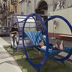 Run for Rest won the Public Design Festival in Milan. Architects Joana Pestana Lages and Maria Joao Fonseca mock modern life by using a hamster wheel like contraption to force one user to work (run) to cradle the second.