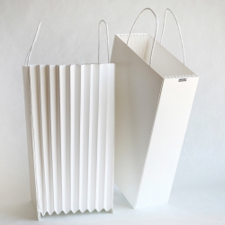 The accordion bag can expands to accommodate more content or can become a paper basket. Justin Lyn design
