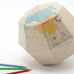 Notemaker has added cool colouring-in globes to its stationery range.