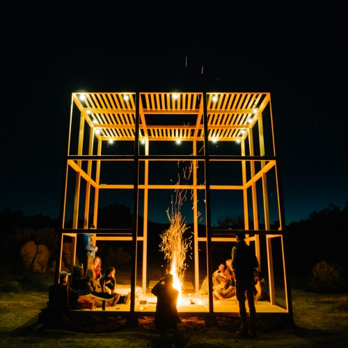 The Desert Pavilion by Designers On Holiday sits in the surreal landscape of Joshua Tree. This wooden cube features a hidden fire pit for those chilly desert nights.