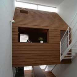 designed by ryoichi kojima, this house, located in ota-ku, tokyo. is a three-storey single family house where the living room is a wooden cabin suspended between the two side walls.