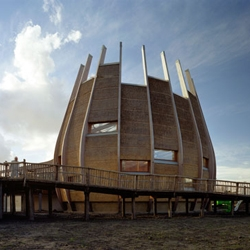 Dutch architects LAM have completed a beautiful sustainable giraffe enclosure for Rotterdam Zoo.