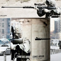 What goes around comes around ~ smart anti-war ads wrapped around poles...