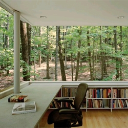 The Scholar's Library is a small, self-contained library and study in the middle of the woods. By Peter Gluck and Partners.