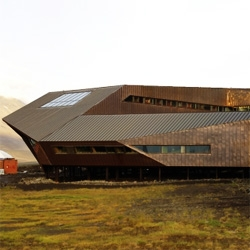 The Svalbard Science Center in Norway may look like a spaceship,  but actually its folded edges protect windows and doors from snow. By JVA.