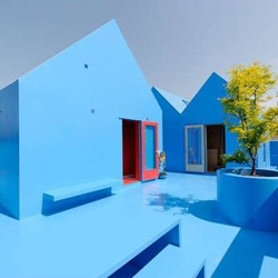 MVDRV have been on NOTCOT before. This project: Didden Village, is in Rotterdam. Not only is the blue entrancing, the interior is a space I could happily live in. Check out the stairs.