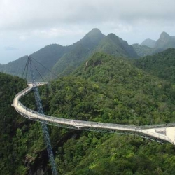 The sky bridge in Langkawi, Malaysia is a curved suspension bridge guyed to ONE pole.