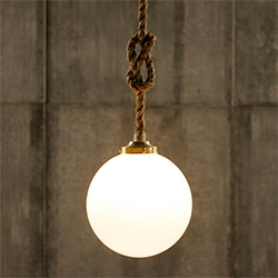 Luke Lamp Co. The Broadway - a rope pendant light with a large glass globe