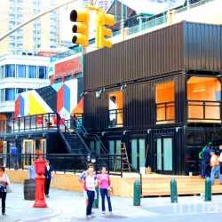 A three-story shipping container beer garden/mini-mall/food court is now open for business at South Street Seaport.
