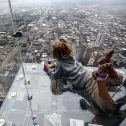 Chicago's Sears Tower has unveiled glass balconies at 1,353 feet.  Could you step out onto one of these?