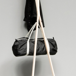 Sebastian Schönheit's Astgabel (Crotch) coatrack has a reduced form and shape, standing nonchalantly ontwo feet to let it lean against a wall. Mouldings at the bar's ends offer plenty of possibilities to store hats, scarfs and coats.