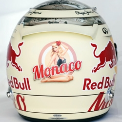 Sebastian Vettel's custom helmet for the 2013 F1 Gran Prix of Monaco includes a tribute to the a few of the greatest Monaco races and a the pin-up girl goes topless as it heats up.