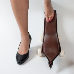 Secret is an intimate skateboard for women, part of the Gesture Boards collection. Soft leather and foam over molded plywood curves make it perfect to be used with bare feet under a desk.