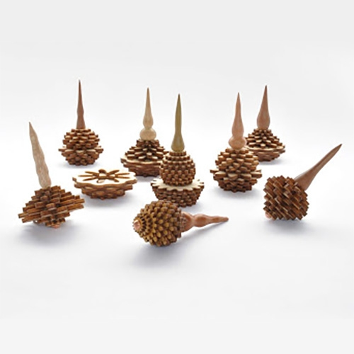 Conos - wooden spinning tops inspired by seeds. Designed and manufactured by chilean designer/jeweler Nicolás Hernández.