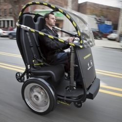 Segway and GM partner to create the P.U.M.A. - Personal Urban Mobility and Accessibility vehicle. It's a two-wheeled vehicle that balances on gyroscopes and is powered by rechargeable batteries.  Coming 2012.