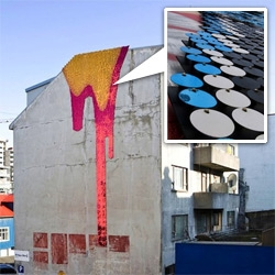Using Sequins, plastic, and plywood New York-based artist, Theresa Himmer creates shiny, pixilated installations dripping from the top of buildings.