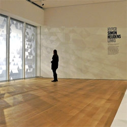 Shade by Simon Heijdens at the Art Institute Chicago uses natural light to cast shadows across a room with a special film across the windows.
