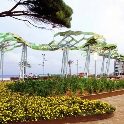 At a beachside park in Spain, architects built a shade structure that mimics the look and swaying action of nearby pine trees. Since new trees would never to grow in the salty air conditions near the beach, they created a stunning replica of a grove of pine trees.