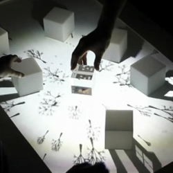 Augmented Shadow is a tabletop interface on where artificial shadows of tangible objects displayed. By Joon Moon with openframeworks.