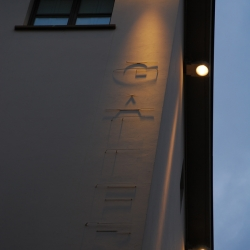 The sign for the Gallery Hotel Art in Florence is very discrete - you can only see it at night.