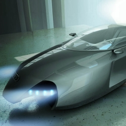The Audi Shark is a futuristic flying concept vehicle with a streamlined design inspired by motorcycles and airplanes. It was designed by Kazim Doku and won the Desire Competition by Domus Academy.