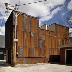 Superkül converted an old  industrial shed into a single family home in midtown Toronto. The use of rusted steel panels makes the new house blend with the existing neighborhood.