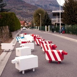 A flock of reflective sheep got lost in the city. By invading the streets, they force drivers to slow down.  Other uses could be a bench, sign holder, flowerpot.  Designed by Christophe Machet.