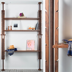 The Comal Shelves, made by Yucca Stuff, use continuous wooden threads to expand into place. They are completely collapsable and fit ceilings both high and low.