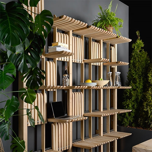 Zakh Architects Gate Shelving/Furniture System. A modular collection of movable wooden bars placed on a metal rod creating dynamic structure changing to fit fast and always changing pace of daily life.