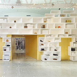 A cool concept for the interiors of the Mameg + Maison Martin Margiela store in Beverly Hills, designed by  Johnston Marklee & Associates: A wall made out of randomly placed containers.