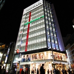 Tokyo's Shinjuku Topshop store gets wrapped in LED gift box design in time for the holidays.