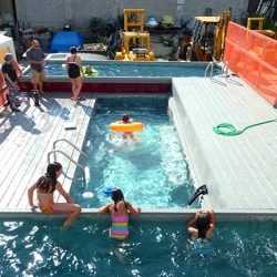 Dive in and go for a swim in this Brooklyn swimming pool made out of dumpsters!