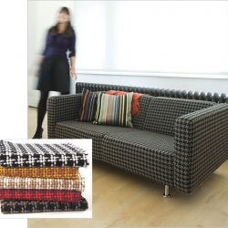 another of my favs from this week's slideshow is this couch.  houndstoothy patterns seem to be really trendy and this couch is just the right combination of frumpy and fun.