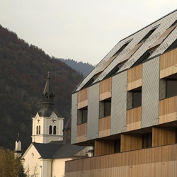 Slovenian architecture office, OFIS, constructed this wooden apartments on a shopping mall roof's with amazing views of the mountains.