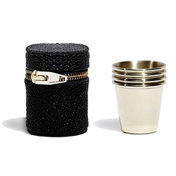 Alexander Wang Set of four pale gold shot glasses in a black snakeskin embossed soft pouch with pale gold zipper closure.