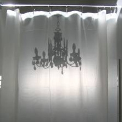 There's something strangely appealing (ok, it makes me laugh) about this chandelier silhouette shower curtain by Catherine David Designs