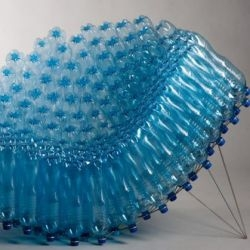 Polish designer Pawel Grunert has created the SIE43 Chair. The chair is made from PET bottles with a stainless steel frame.