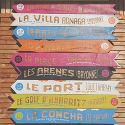 Trendenser found these amazing signs in Biarritz! Love the playful colors, and how the wood shows through for the text.