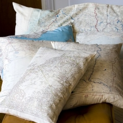 Silk Map Cushions by Alex Jowett of Atelier 688. The history behind these silk map covers carry a piece of World War II history.
