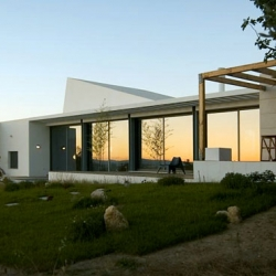 Beautiful house by Portuguese Arquiprojecta. The house has huge windows that lets in light from both sides and gives the house a 360 view of the landscape.