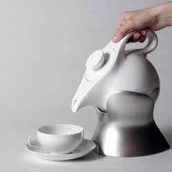 The Lazy Teapot, relieving you of  actually picking up a teapot and pouring its hot water into a cup. Designer Lotte Alpert created a design concept for this teapot and its holding device which boils the water and keeps it warm.