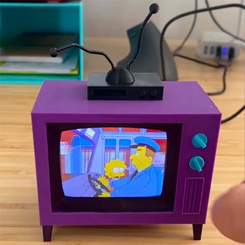 A tiny 3d printed TV (with working dials) that randomly plays Simpsons episodes! Designed and made by redditor buba447.