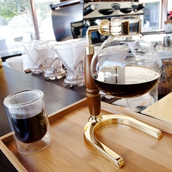 Demitasse ~ Little Tokyo's new cafe and coffee bar features a ever rotating variety of single source coffees like this freshly siphoned pot of Tanzanian Peaberry Kanyovu... and a fun video of the siphon in action!