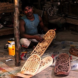 Under the supervision of German curator Tobias Megerle, a dozen Mahim woodcarvers produced their own take on the traditional skateboard, the 'Mumbai skateboard'.